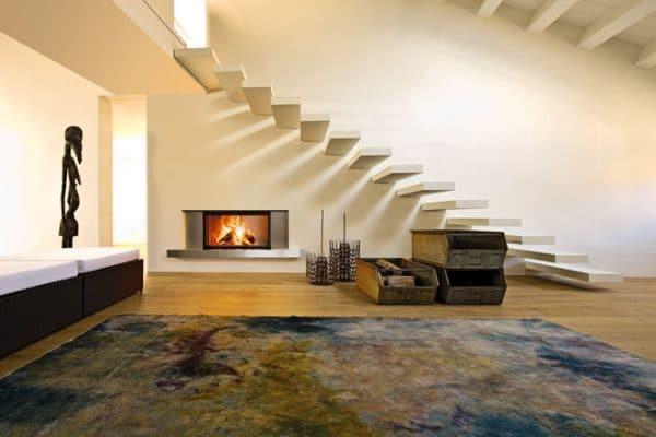 cheminée foyer bois MCZ Plasma 115 avec porte relevable design moderne