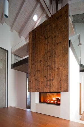 cheminée foyer bois MCZ Plasma 115 avec porte relevable habillage céramique